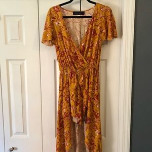 Francesca's romper with high to low skirt overlay